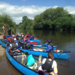 Group of canoes packed and ready to leave on river trip