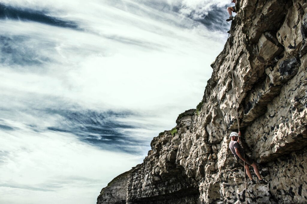 Abseiling down the cliffs at Dancing Ledge in Dorset