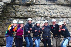 Group celebrating climbing at Dancing Ledge