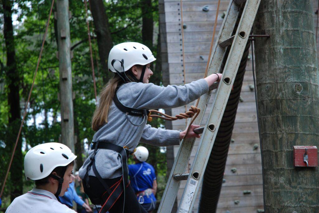 Girl climbing a ladder