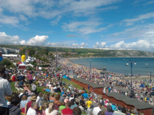 View of crowds watching Swanage Carnival procession
