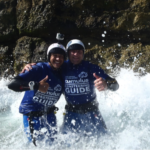Two coasteering instructors