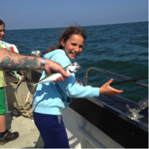 Young girl mackerel fishing