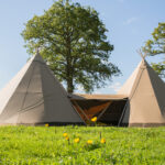 Two tipis linked by central covered way