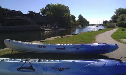 kayaks next to river cumulus outdoor