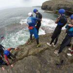 Preparing to jump into the sea at Dancing Ledge