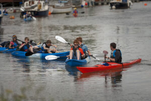 School group kayaking on the River Frome