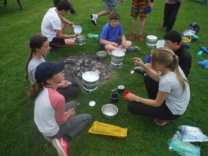 School group cooking on a bushcraft session