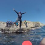 DofE coasteering leap at Dancing Ledge in Isle of Purbeck