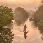 Paddle boarding along the River Stour