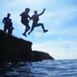Two children coasteering at Dancing Ledge