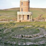 Clavell Tower and original footing overlooking Kimmeridge Bay