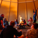 Tipi time around the fire pit