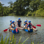 School group with a raft on the lake in Swanage