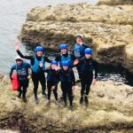 Happy family coasteering group