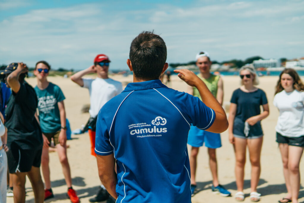Cumulus leader instructing on beach safety