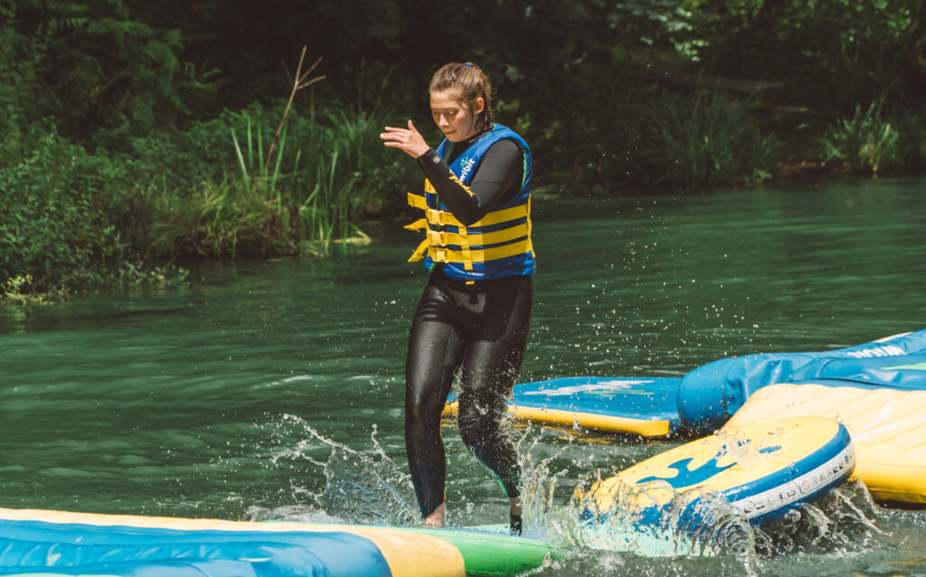 Girl running on waterpark obstacle dofe gold residential
