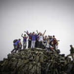 Class of pupils reaching the top of Snowdonia