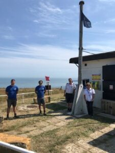 cumulus team with members of coast watch